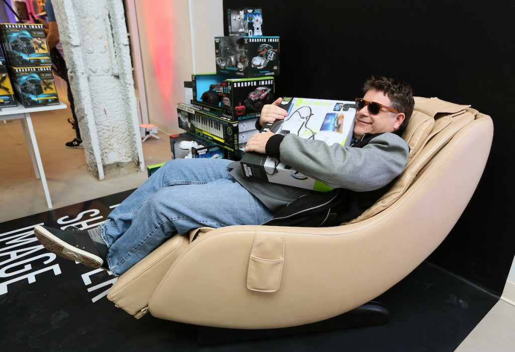 Actor Sean Astin explores his inner nerd at the Sharper Image® pop-up store in New York's Times Square, testing the new Sharper Image massage chair, Thursday, Nov. 9, 2017. From drones of all sizes and radio-controlled toys to hi-tech barware and beyond, Sharper Image offers something for everyone in the family—from the gadget lover or jet-setter, to the kids or kid-at-heart. (Stuart Ramson/AP Images for Sharper Image)
