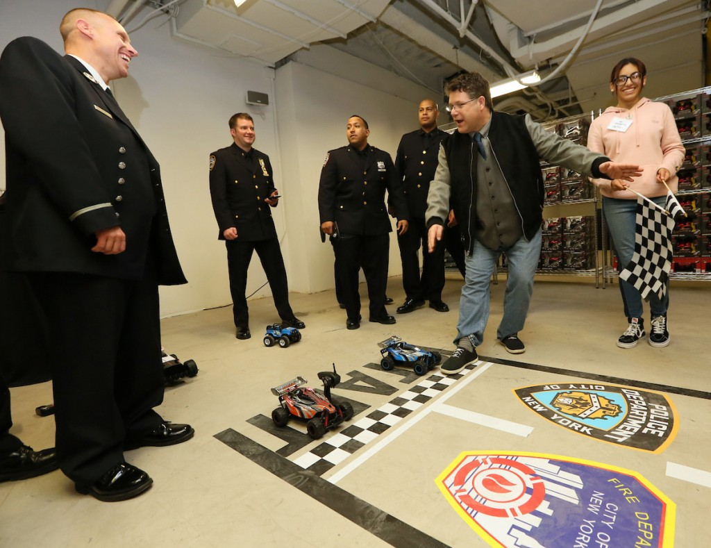 "The New York City Fire and Police Departments and actor Sean Astin race Sharper Image® Radio Controlled Flip Stunt Rally Vehicles at the new pop-up Sharper Image retail location in New York's Times Square, Thursday, Nov. 9, 2017. This holiday season, Sharper Image is giving consumers a reason to ""shop sharper"" by helping them all shop wiser with a thoughtfully-curated selection of premium gifts for play and the home, available at the pop-up and at retail partners across the country. (Stuart Ramson/AP Images for Sharper Image)"